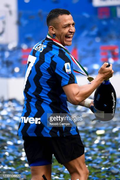 Alexis Sanchez of FC Internazionale celebrates during the award ceremony after the Serie A football match between FC Internazionale and Udinese...