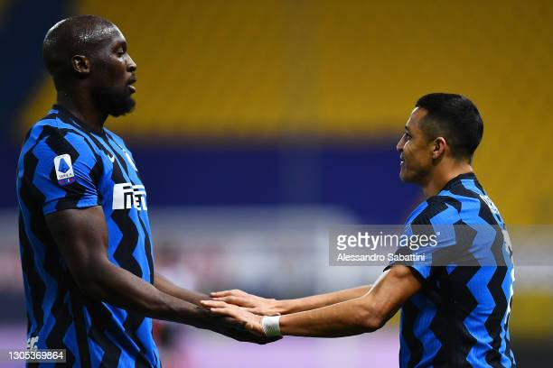 Alexis Sanchez of FC Internazionale celebrates with teammate Romelu Lukaku after scoring his team's second goal during the Serie A match between...