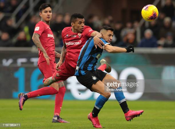 Alexis Sanchez of FC Internazionale competes for the ball with Henrique Dalbert of ACF Fiorentina during the Coppa Italia Quarter Final match between...