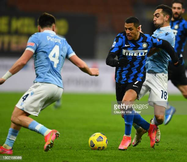 Alexis Sanchez of FC Internazionale competes for the ball with Gonzalo Escalante of SS Lazio during the Serie A match between FC Internazionale and...