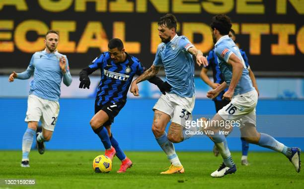 Alexis Sanchez of FC Internazionale competes for the ball with Francesco Acerbi of SS Lazio during the Serie A match between FC Internazionale and SS...