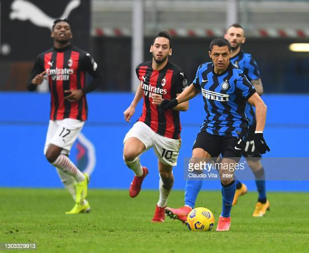 Alexis Sanchez of FC Internazionale in action during the Serie A match between AC Milan and FC Internazionale at Stadio Giuseppe Meazza on February...