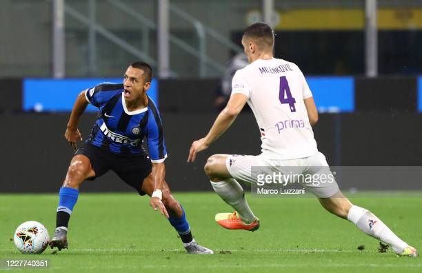 Alexis Sanchez of FC Internazionale is challenged by Nikola Milenkovic of ACF Fiorentina during the Serie A match between FC Internazionale and ACF...