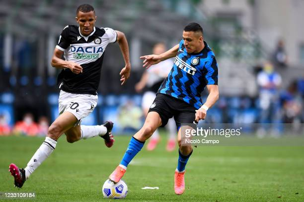 Alexis Sanchez of FC Internazionale is challenged by Rodrigo Becao of Udinese Calcio during the Serie A football match between FC Internazionale and...