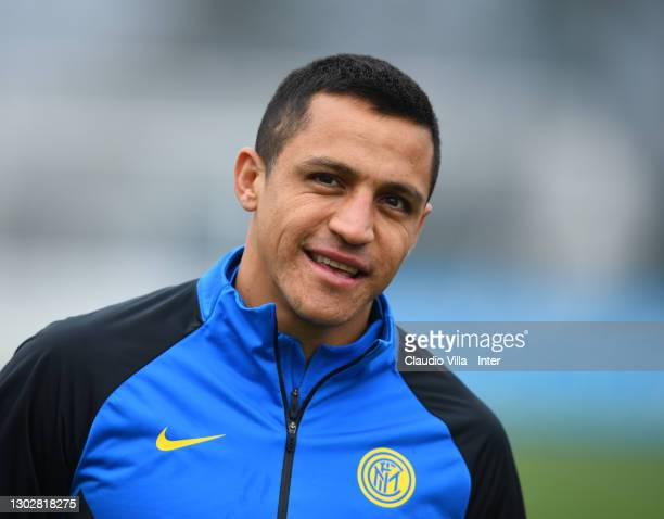 Alexis Sanchez of FC Internazionale looks on during a training session at Appiano Gentile on February 18, 2021 in Como, Italy.