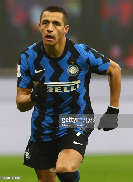 Alexis Sanchez of FC Internazionale looks on during the Coppa Italia semi-final match between FC Internazionale and Juventus at Stadio Giuseppe...