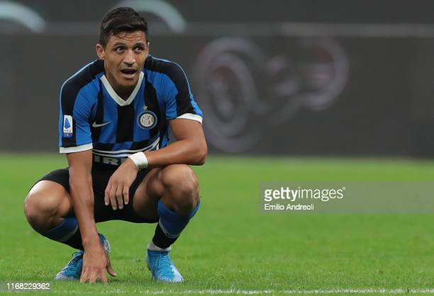 Alexis Sanchez of FC Internazionale looks on during the Serie A match between FC Internazionale and Udinese Calcio at Stadio Giuseppe Meazza on...