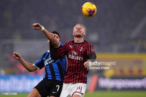 Alexis Sanchez of FC Internazionale Milano Simon Kjaer of AC Milan during the Italian Serie A match between Internazionale v AC Milan at the San Siro...