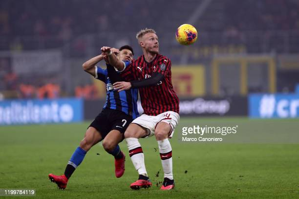 Alexis Sanchez of FC Internazionale Simon Kjaer of Ac Milan in action during the the Serie A match between Fc Internazionale and Ac Milan. Fc...