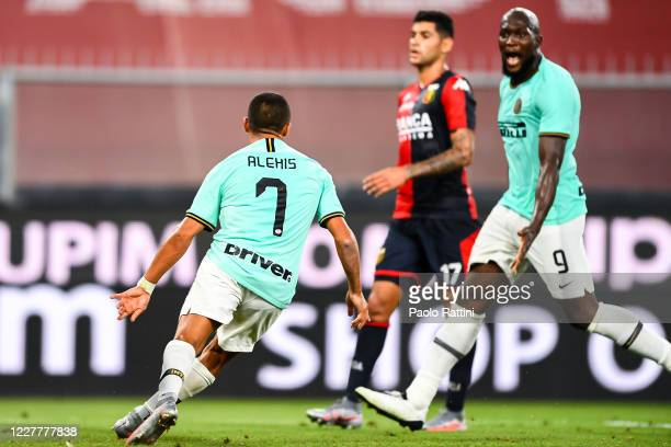 Alexis Sanchez of Inter celebrates with his team-mate Romelu Lukaku after scoring a goal during the Serie A match between Genoa CFC and FC...