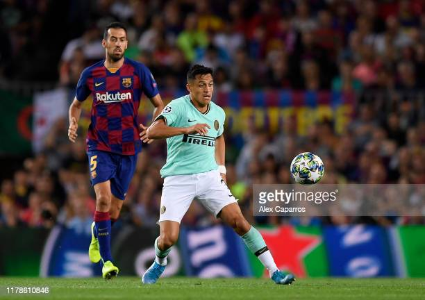 Alexis Sanchez of Inter Milan is closed down by Sergio Busquets of FC Barcelona during the UEFA Champions League group F match between FC Barcelona...