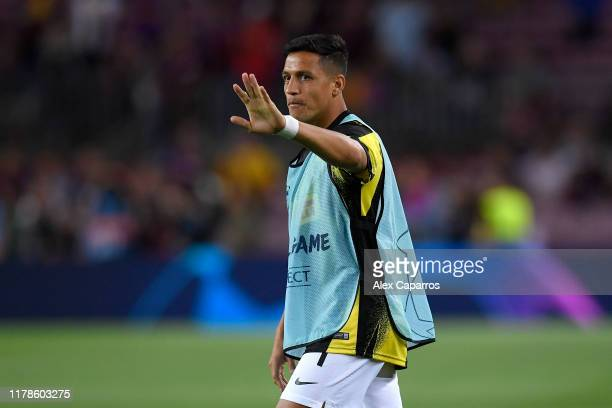 Alexis Sanchez of Inter Milan warms up prior to the UEFA Champions League group F match between FC Barcelona and FC Internazionale at Camp Nou on...