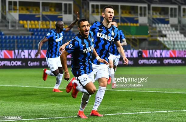 Alexis Sanchez of Internazionale celebrates with team mate Ivan Perisic after scoring their side's first goal during the Serie A match between Parma...