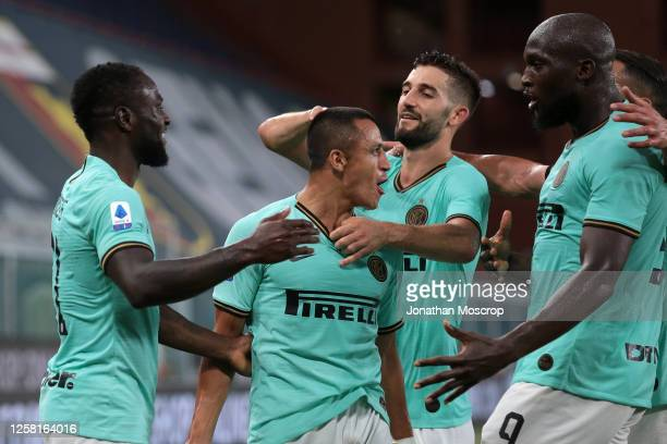 Alexis Sanchez of Internazionale celebrates with team mates after scoring to give the side a 2-0 lead during the Serie A match between Genoa CFC and...