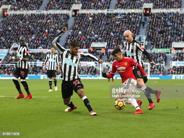 Alexis Sanchez of Man United runs into the packed Newcastle defence with DeAndre Yedlin standing firm watched by Jonjo Shelvey during the Premier...