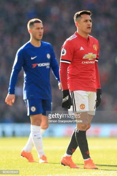 Alexis Sanchez of Man Utd and Eden Hazard of Chelsea looks on during the Premier League match between Manchester United and Chelsea at Old Trafford...