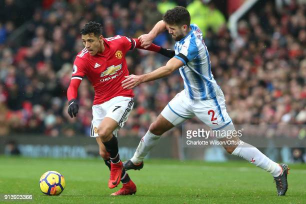 Alexis Sanchez of Man Utd and Tommy Smith of Huddersfield battle for the ball during the Premier League match between Manchester United and...
