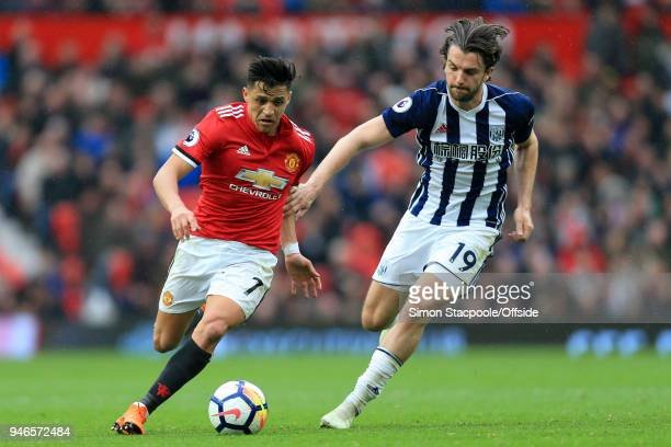 Alexis Sanchez of Man Utd battles with Jay Rodriguez of West Brom during the Premier League match between Manchester United and West Bromwich Albion...