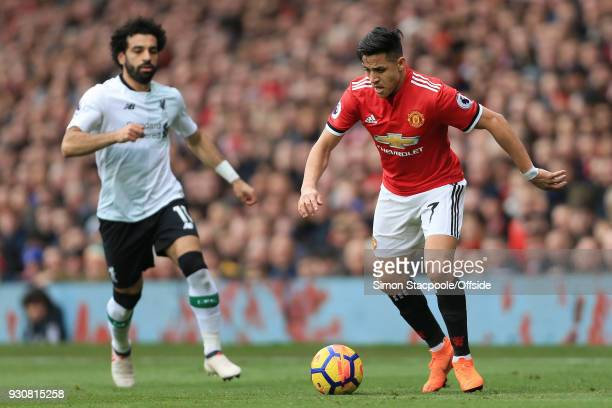 Alexis Sanchez of Man Utd battles with Mohamed Salah of Liverpool during the Premier League match between Manchester United and Liverpool at Old...