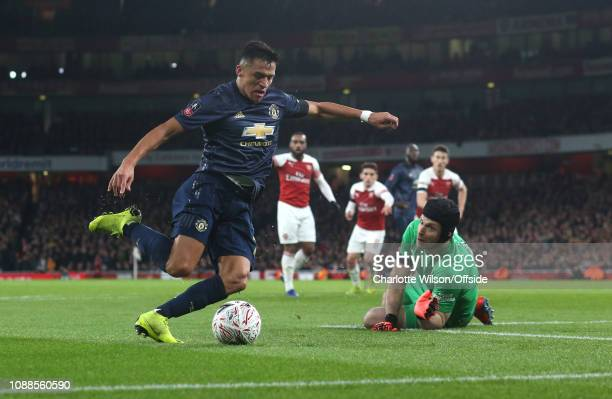 Alexis Sanchez of Man Utd beats Arsenal goalkeeper Petr Cech to score the opening goal during the FA Cup Fourth Round match between Arsenal and...