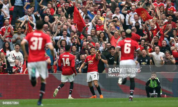 Alexis Sanchez of Man Utd celebrates his goal with colleagues and United supporters during the FA Cup semi final between Manchester United and...