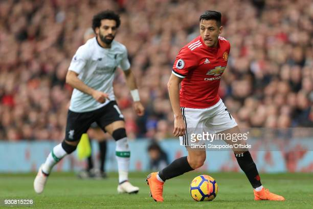 Alexis Sanchez of Man Utd gets away from Mohamed Salah of Liverpool during the Premier League match between Manchester United and Liverpool at Old...
