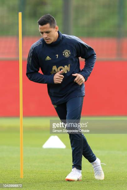 Alexis Sanchez of Man Utd in action during a training session ahead of their UEFA Champions League Group H match against Valencia at the Aon Training...