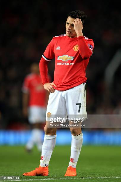 Alexis Sanchez of Man Utd looks dejected during the UEFA Champions League Round of 16 Second Leg match between Manchester United and Sevilla FC at...