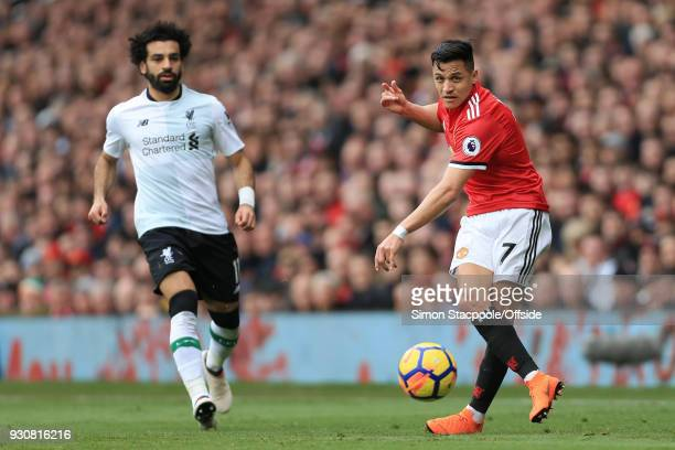 Alexis Sanchez of Man Utd passes the ball away from Mohamed Salah of Liverpool during the Premier League match between Manchester United and...