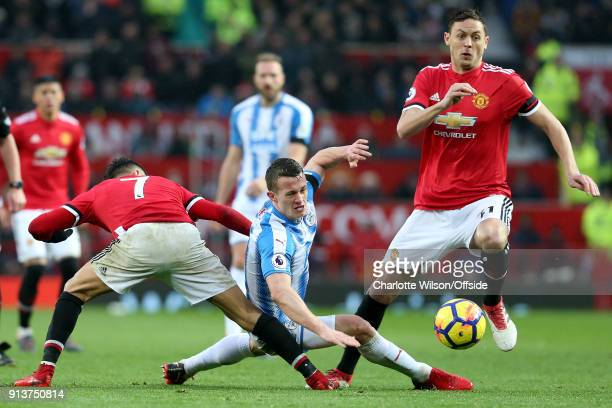 Alexis Sanchez of Man Utd tackles Jonathan Hogg of Huddersfield to leave the ball open for Nemanja Matic of Man Utd during the Premier League match...