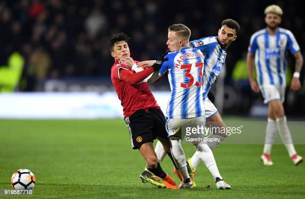 Alexis Sanchez of Manchester United and Florent Hadergjonaj of Huddersfield Town clash during the The Emirates FA Cup Fifth Round between...
