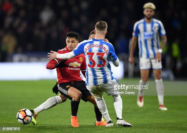 Alexis Sanchez of Manchester United and Florent Hadergjonaj of Huddersfield Town battle for the ball during the The Emirates FA Cup Fifth Round...
