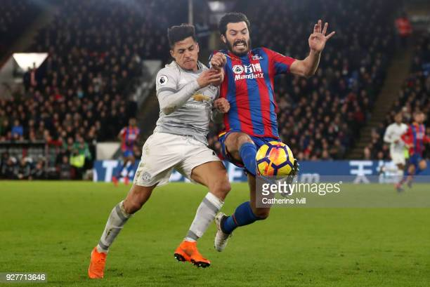Alexis Sanchez of Manchester United and James Tomkins of Crystal Palace in action during the Premier League match between Crystal Palace and...