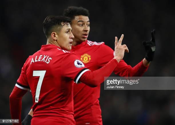 Alexis Sanchez of Manchester United and Jesse Lingard of Manchester United line up a wall during the Premier League match between Tottenham Hotspur...