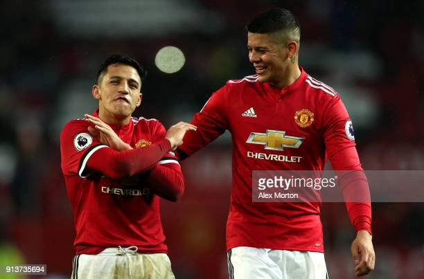 Alexis Sanchez of Manchester United and Marcos Rojo of Manchester United react after the Premier League match between Manchester United and...