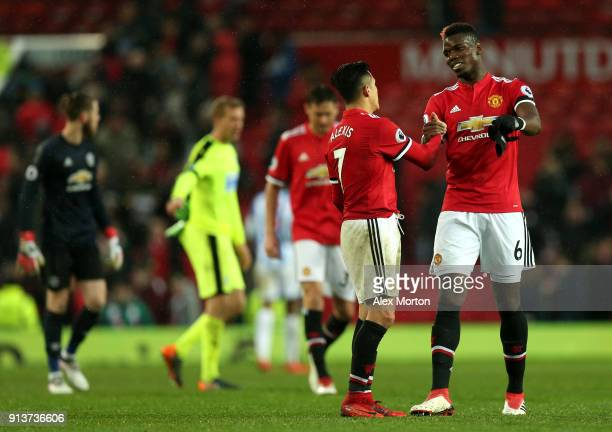 Alexis Sanchez of Manchester United and Paul Pogba shake hands following the Premier League match between Manchester United and Huddersfield Town at...