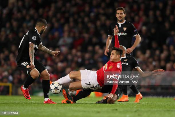 Alexis Sanchez of Manchester United and Steven N'Zonzi of Sevilla during the UEFA Champions League Round of 16 Second Leg match between Manchester...