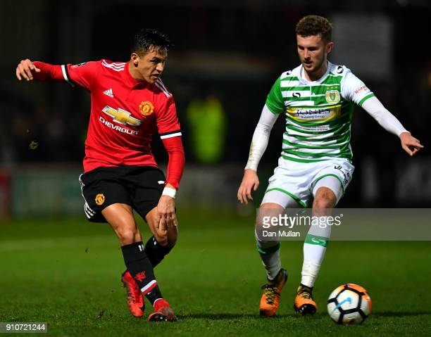 Alexis Sanchez of Manchester United and Tom James of Yeovil Town in action during The Emirates FA Cup Fourth Round match between Yeovil Town and...