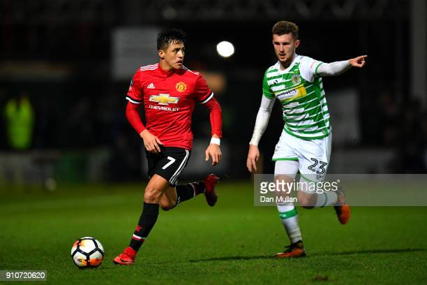 Alexis Sanchez of Manchester United and Tom James of Yeovil Town during The Emirates FA Cup Fourth Round match between Yeovil Town and Manchester...