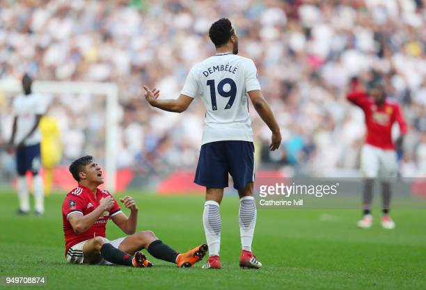Alexis Sanchez of Manchester United argues with Mousa Dembele of Tottenham Hotspur during The Emirates FA Cup Semi Final between Manchester United...
