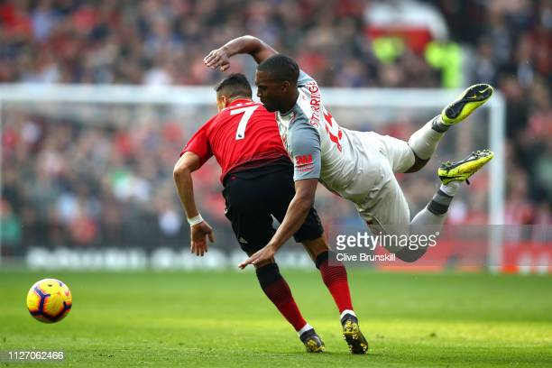 Alexis Sanchez of Manchester United battles for possession with Daniel Sturridge of Liverpool during the Premier League match between Manchester...