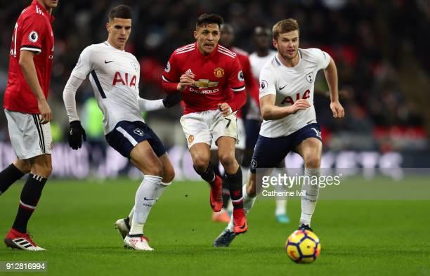 Alexis Sanchez of Manchester United battles with Erik Lamela and Eric Dier of Tottenham Hotspur during the Premier League match between Tottenham...