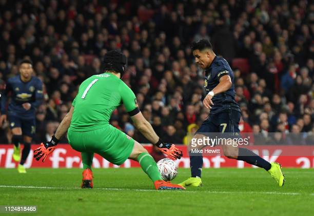 Alexis Sanchez of Manchester United beats Petr Cech of Arsenal as he scores his team's first goal during the FA Cup Fourth Round match between...