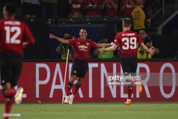 Alexis Sanchez of Manchester United celebrates after scoring a goal to make it 01 during the International Champions Cup 2018 match between AC Milan...