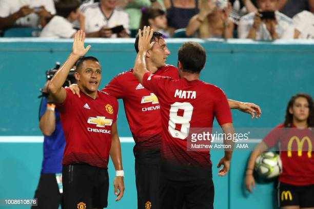Alexis Sanchez of Manchester United celebrates after scoring a goal to make it 10 during the International Champions Cup 2018 fixture between...
