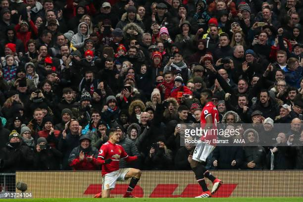 Alexis Sanchez of Manchester United celebrates after scoring a goal to make it 20 during the Premier League match between Manchester United and...