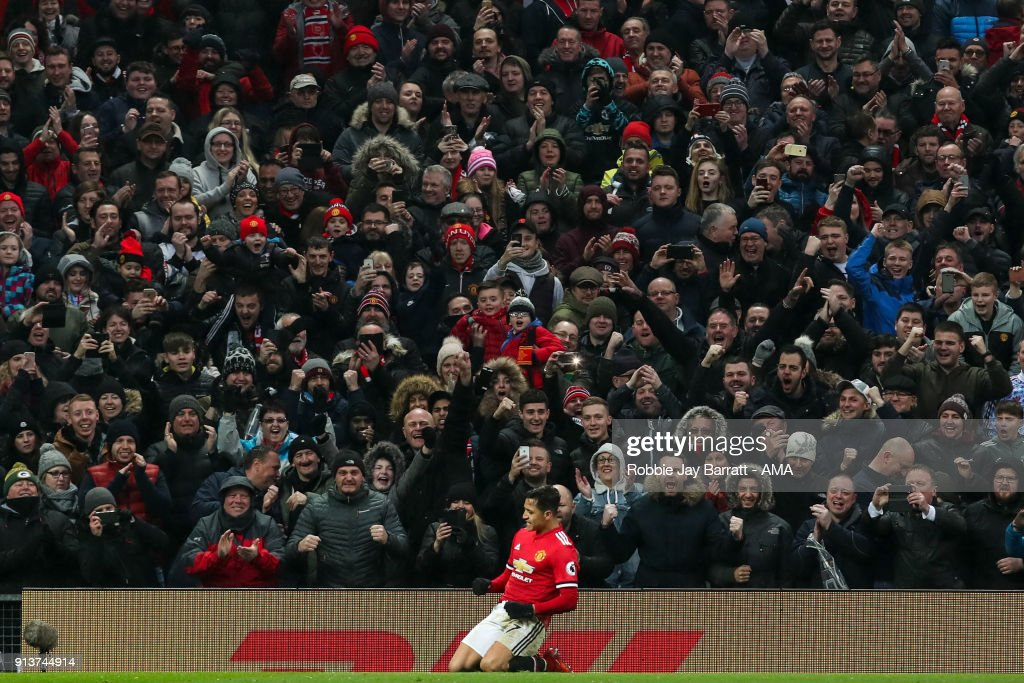 Alexis Sanchez of Manchester United celebrates after scoring a goal to make it 2-0 during the Premier League match between Manchester United and Huddersfield Town at Old Trafford on February 3, 2018 in Manchester, England.
