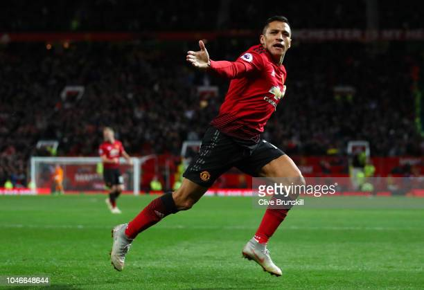 Alexis Sanchez of Manchester United celebrates after scoring his team's third goal during the Premier League match between Manchester United and...