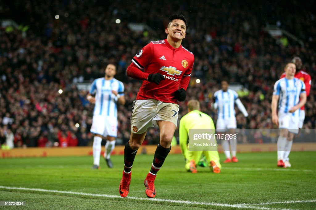 Alexis Sanchez of Manchester United celebrates after scoring his sides second goal during the Premier League match between Manchester United and Huddersfield Town at Old Trafford on February 3, 2018 in Manchester, England.