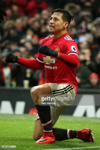 Alexis Sanchez of Manchester United celebrates after scoring his sides second goal during the Premier League match between Manchester United and...
